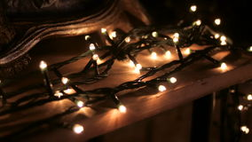 Luminous garlands on the table, the fireplace stock footage