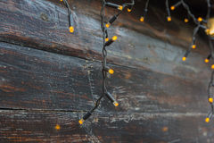 Luminous garlands on a wooden background Stock Photography
