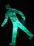 Luminous green walking sign Royalty Free Stock Photography