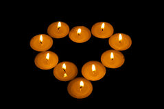 Luminous heart from candle Royalty Free Stock Photography