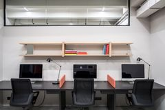 Stylish office in loft style with gray walls Stock Images