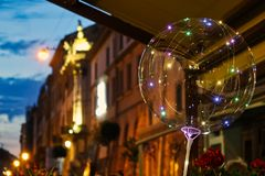 Luminous led lamp in a balloon on the terrace in the old city in the evening royalty free stock photography