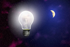 Luminous light on the background of the sky with  moon Royalty Free Stock Images