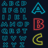 Luminous neon alphabet Vector font. The color of light is easily changed. Neon letters on a dark blue background isolated.  Stock Photos