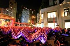 Luminous Night Dragon Dance at Temple Fair 2016. 500-Feet Luminous Night Dragon Dance is the highlight before the closing of annual temple fair at HK Royalty Free Stock Photo