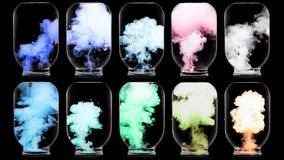 Luminous paint swirling in water. Royalty Free Stock Photos