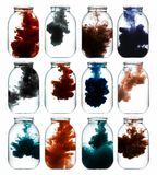 Luminous paint swirling in water. Stock Images