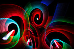 Luminous patterns in form of spirals. Abstract luminous patterns in form of spirals on black background Stock Images