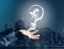 Luminous question mark displayed on a futuristic interface - Inn Stock Photo