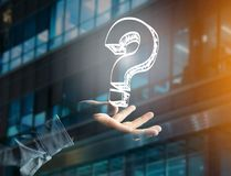 Luminous question mark displayed on a futuristic interface - Inn Stock Photography