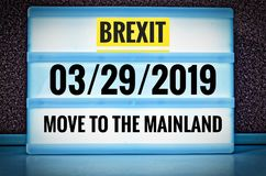 Luminous sign with inscription in english Brexit and 03/29/2019 and move to the mainland, in german 29.03.2019 und zieh aufs Festl. And, symbolizing the royalty free stock images