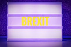 Luminous sign with inscription in German Brexit, symbolizing the withdrawal of Great Britain from the EU.  royalty free stock photography