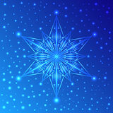 Luminous snowflake on blue background with sparkles Royalty Free Stock Image