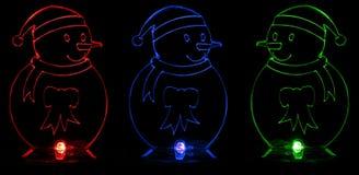 Luminous snowmen Stock Photos