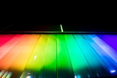 luminous spectrum composed of prisms and projected on a wall wit royalty free stock photography