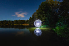 Luminous sphere near the lake Royalty Free Stock Images