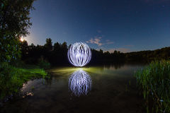 Luminous sphere near the lake Royalty Free Stock Photography