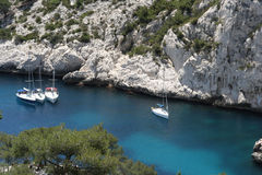 Luminy yachts. Yachts moored in the crystal clear waters of luminy calanque, near marseille, france royalty free stock photo