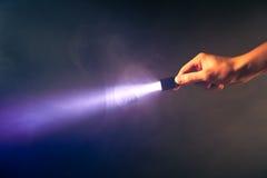Lumière rougeoyante de torche de poche Images stock