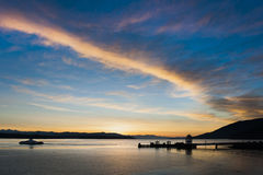 Lummi Island Sunrise. An incredible sunrise greets commuters on an island in the Puget Sound area of western Washington State Royalty Free Stock Photography