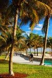 Lummus Park Miami Beach. A bike rider heads along a pah in Lumus Park in Miami Beach stock photography