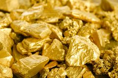 Lump of gold mine. Close up lump of gold mine background texture stock photos
