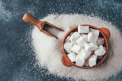 Lump and granulated refined sugar. On the wooden background stock photo