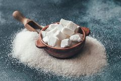 Lump and granulated refined sugar. On the wooden background royalty free stock photos