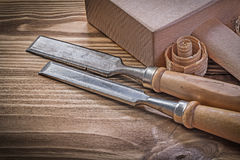 Lump hammer chisels curled scobs on vintage wood board construct. Ion concept Stock Photos