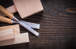 Lump hammer firmer chisels and wooden planks on Royalty Free Stock Photo