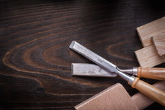 Lump hammer firmer chisels and wooden planks on brown vintage wo Royalty Free Stock Photo