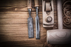 Lump hammer planer firmer chisels planning chips on vintage wood Royalty Free Stock Photography