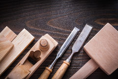 Lump hammer planer firmer chisels and wooden planks on brown har. Dwood construction concept Stock Image
