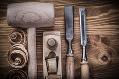 Lump hammer shaving plane firmer chisels planning chips on vinta Royalty Free Stock Images