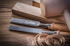 Lump hammer wooden stud firmer chisels planning chips on vintage Royalty Free Stock Photo