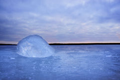 Lump of ice on frozen lake Royalty Free Stock Image