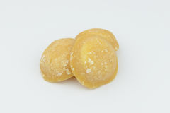 Lump of palm sugar, jaggery, isolate background Royalty Free Stock Photos