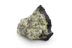 Lump of rock with green crystals over white Stock Photo