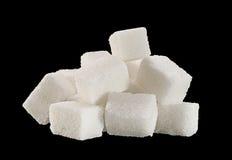 Lump sugar cube. Isolated on black background stock image