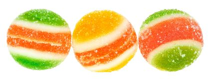 Multicolored fruit candy isolated. Lump sugar on a white background Stock Photos