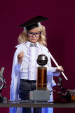 Lumped little blonde conducting an experiment Stock Photography