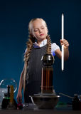 Lumped schoolgirl posing with glowing lamp Stock Images