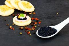 Lumpfish caviar and Homemade pancake canape royalty free stock photo