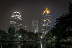 Lumphini park Bangkok downtown city at night. Thailand Stock Photo
