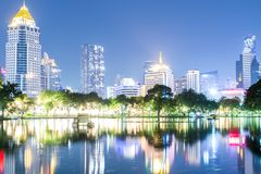 Lumpini park and Bangkok city central business downtown landscape at night time, Bangkok,Thailand. Lumpini park and Bangkok city central business downtown stock images
