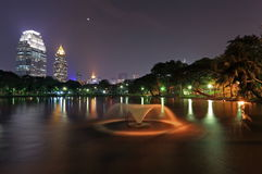 Lumpini Park, Bangkok, Thailand. Night view of Bangkok from Lumpini Park, Bangkok, Thailand Royalty Free Stock Photos