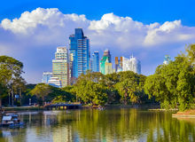 Lumpini Park , lake , modern apartments   in downtown Bangkok Stock Photos