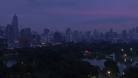 Lumpini Park timelapse from night to day, Bangkok city, Thailand.  stock video