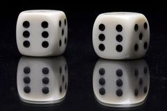 Lumps. Ivory gamble cubes on glass with reflex royalty free stock images