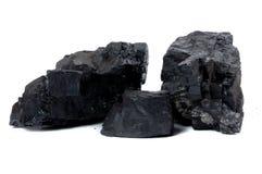 Lumps of coal. Isolated on white background Stock Photos